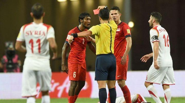 madhu red card syria.jpg
